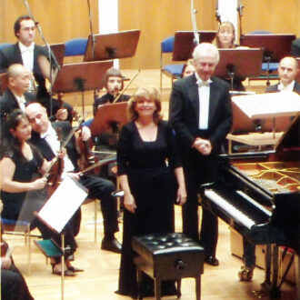İdil Biret and conductor Antoni Witt saluting the audience with Bilkent Symphony Orchestra after a concert where Beethoven's concerti were performed by Biret, 22 January 2008.