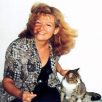 İdil Biret with one of her cats. Tunisia, 1990′s. Photo: Şefik Yüksel