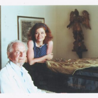 Idil with Kempff at his house in Positano (June 1982) (Note from Sefik Yüksel: That evening Kempff was in a particularly good mood. He wanted to play Schubert sonatas to Idil. After about an hour, when he finished playing the sun was setting and the light was particularly good when this picture was taken.)""